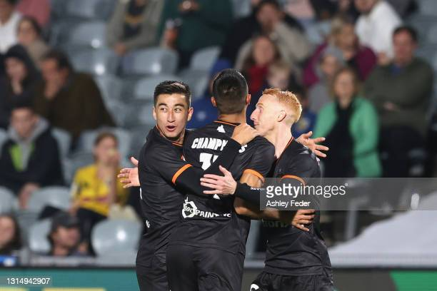 Joseph Champness of Brisbane Roar celebrates his goal with team mates during the A-League match between the Central Coast Mariners and the Brisbane...