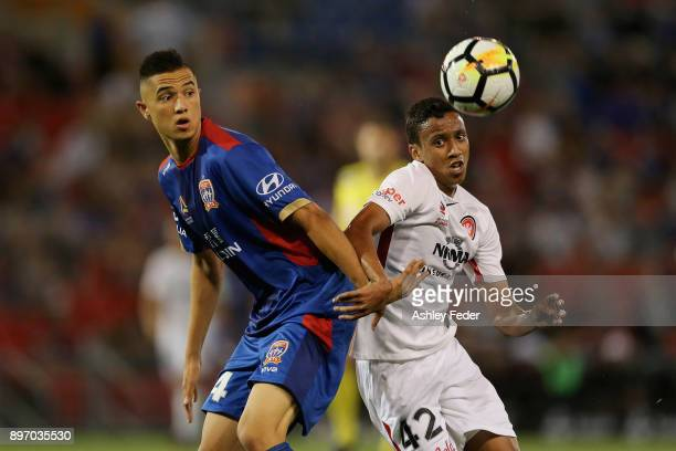Joseph Champness of the Jets contests the ball against Keanu Baccus of the Wanderers during the round 12 ALeague match between the Newcastle Jets and...