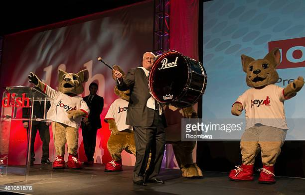 Joseph Clayton chief executive officer for Dish Network Corp bangs a drum while arriving for a press conference during the 2015 Consumer Electronics...