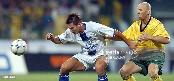 Joseph Cole of Chelsea FC London fights for the ball with Miroslav Barcik of MSK Zilina during the 3rd preliminary round qualifing match of the UEFA...