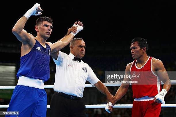 Joseph Cordina of Great Britain celebrates victory over Charly Coronel Suarez of Philippines during their Men's Light 60 kg Preliminary bout on Day 1...