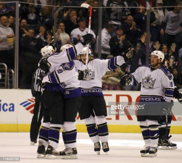 Joseph Corvo of the Los Angeles Kings is embraced by Nathan Dempsey after scoring a goal in the third period of 43 overtime loss to the San Jose...