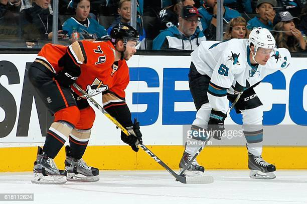 Joseph Cramarossa of the Anaheim Ducks and Justin Braun of the San Jose Sharks look on during a NHL game against at SAP Center at San Jose on October...