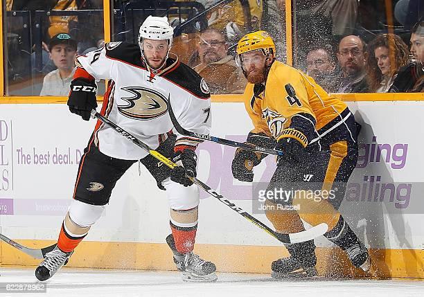Joseph Cramarossa of the Anaheim Ducks battles for the puck against Ryan Ellis of the Nashville Predators during an NHL game at Bridgestone Arena on...