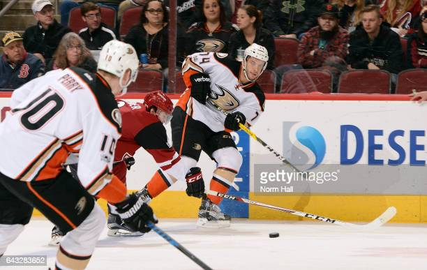 Joseph Cramarossa of the Anaheim Ducks passes the puck to teammate Corey Perry as Tobias Rieder of the Arizona Coyotes defends during the first...