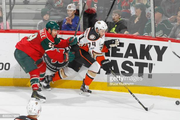 Joseph Cramarossa of the Anaheim Ducks skates to the puck with Jason Pominville of the Minnesota Wild defending during the game on February 14 2017...