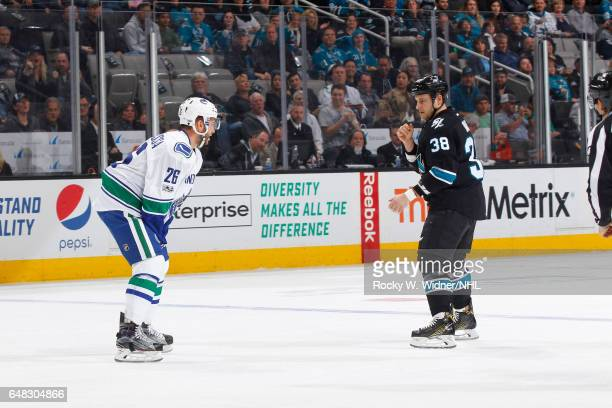 Joseph Cramarossa of the Vancouver Canucks and Michael Haley of the San Jose Sharks get into an altercation during the game at SAP Center on March 2...