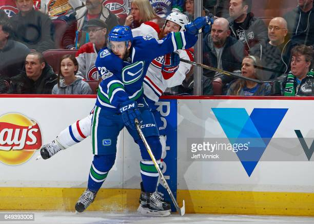 Joseph Cramarossa of the Vancouver Canucks checks Jordie Benn of the Montreal Canadiens during their NHL game at Rogers Arena March 7 2017 in...
