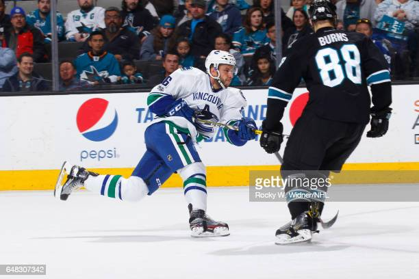 Joseph Cramarossa of the Vancouver Canucks shoots the puck against Brent Burns of the San Jose Sharks at SAP Center on March 2 2017 in San Jose...