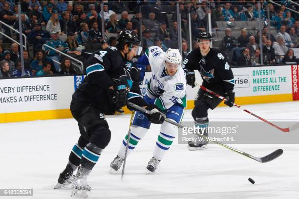 Joseph Cramarossa of the Vancouver Canucks skates against Brenden Dillon of the San Jose Sharks at SAP Center on March 2 2017 in San Jose California