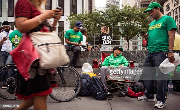 Joseph Cruz and Brian Ceballo wait in line for the iPhone 6 to go on sale outside the Apple store on Fifth Avenue on September 18 2014 in New York...