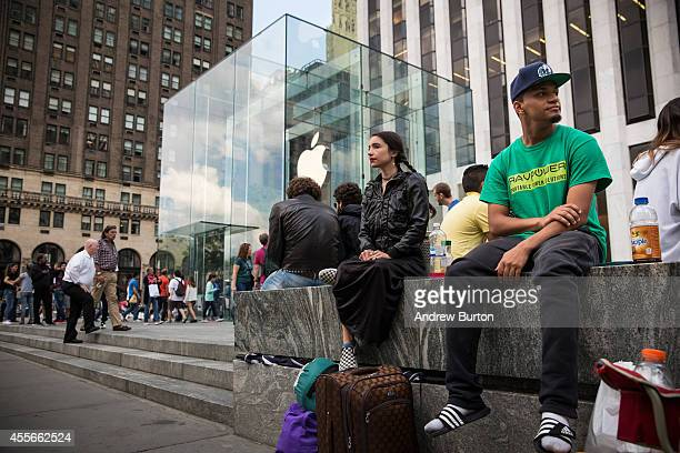 Joseph Cruz waits in line for the iPhone 6 to go on sale outside the Apple store on Fifth Avenue on September 18 2014 in New York City Cruz says he...