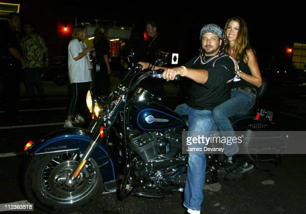 Joseph D Reitman and Shannon Elizabeth during *NSYNC Challenge for the Children IV VIP Party at Harley Davidson store at Harley Davidson store in...