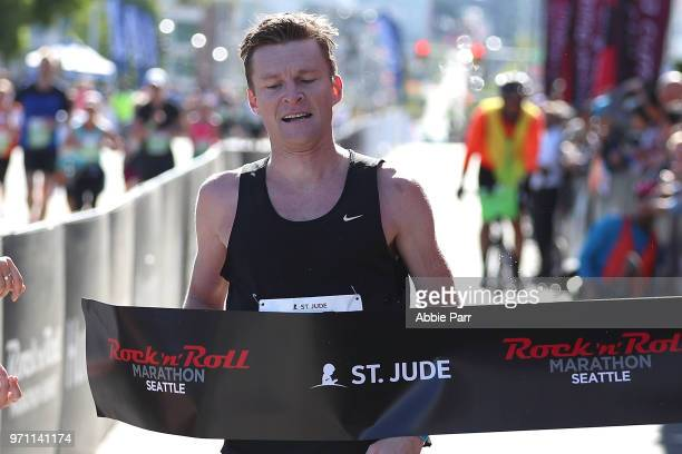 Joseph Darda crosses the finish line to win the Men's Marathon during the St Jude Rock 'n' Roll Seattle Marathon 1/2 Marathon on June 10 2018 in...