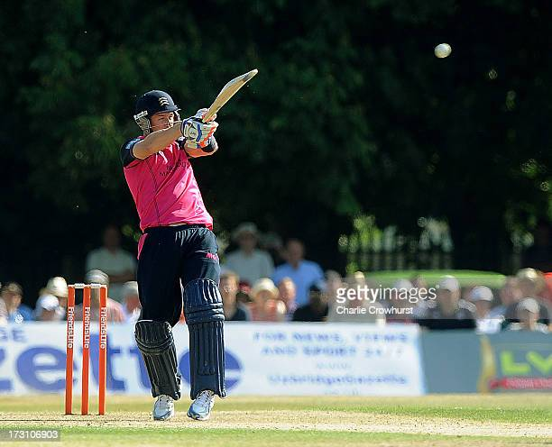 Joseph Denly of Middlesex slogs the ball during the Friends Life T20 match between Middlesex Panthers and Kent Spitfires at Uxbridge Cricket Club on...