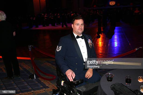 Joseph Deslauriers technical sergeant in the US Air Force who was injured in 2011 in Afghanistan attends the Commanderin Chief Ball at the Walter E...