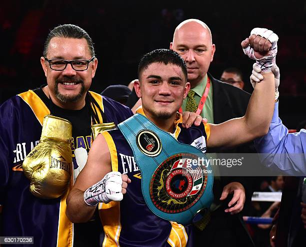 Joseph Diaz Jr poses with his belt after beating Horacio Garcia in a unanamous decision to win the NABF Featherweight title at The Forum on December...