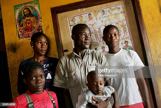 Joseph Duo a former Liberian government soldier appears with his wife Janjay and children Rose Chevelle and Kuku 1 at his home October 5 2005 in...