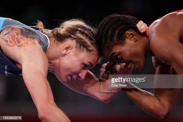 Joseph Emilienne Essombe Tiako of Team Cameroon competes against Roksana Marta Zasina of Team Poland during the Women's Freestyle 53kg Repechage on...