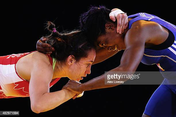 Joseph Essombe Tiako of Cameroon and Brttanee Laverdure of Canada compete in the Quarter Final of the 55kg Women's Wrestling at Scottish Exhibition...