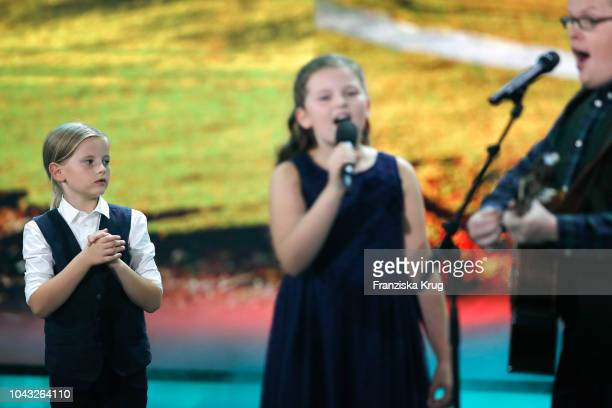 Joseph Ewan Gregory Walter Kelly Mary Emma Kelly and their father Angelo Kelly perform during the television show 'Willkommen bei Carmen Nebel' at...