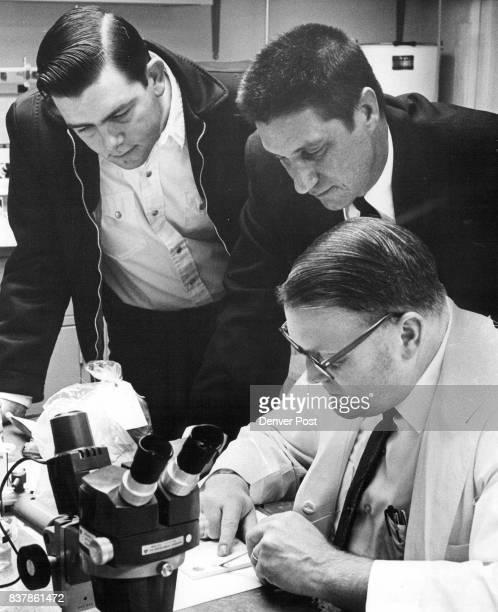 NOV 13 1969 NOV 15 1969 NOV 16 1969 'Joseph F Moomaw right analyzes suspected LSD brought to lab by Sheriff Carrol Whitmire center and Deputy Tom...