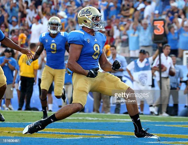 Joseph Fauria of the UCLA Bruins ccelebrates a four yard touchdown catch in the second quarter against the Nebraska Cornhuskers at the Rose Bowl on...