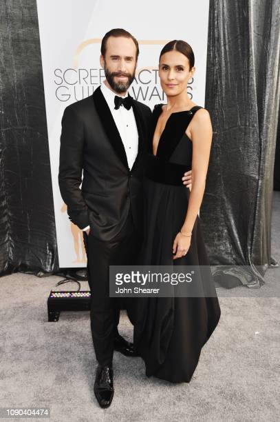 Joseph Fiennes and Maria Dolores Dieguez attend the 25th Annual Screen Actors Guild Awards at The Shrine Auditorium on January 27 2019 in Los Angeles...