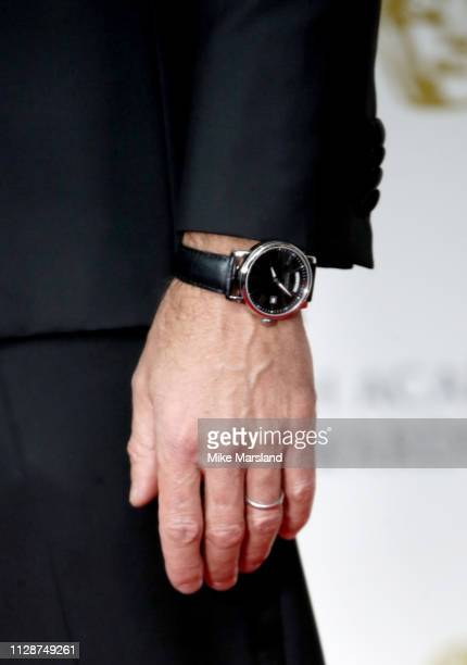 Joseph Fiennes watch detail poses in the press room during the EE British Academy Film Awards at Royal Albert Hall on February 10 2019 in London...