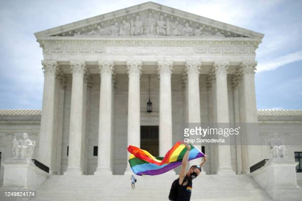 Joseph Fons holding a Pride Flag, walks back and forth in front of the U.S. Supreme Court building after the court ruled that LGBTQ people can not be...