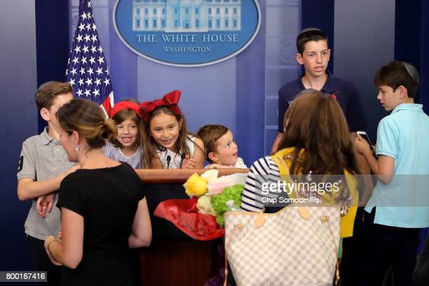 Joseph Frederick Kushner his 5yearold sister Arabella Rose Kushner and friends play with the lecturn in the James Brady Press Briefing Room following...