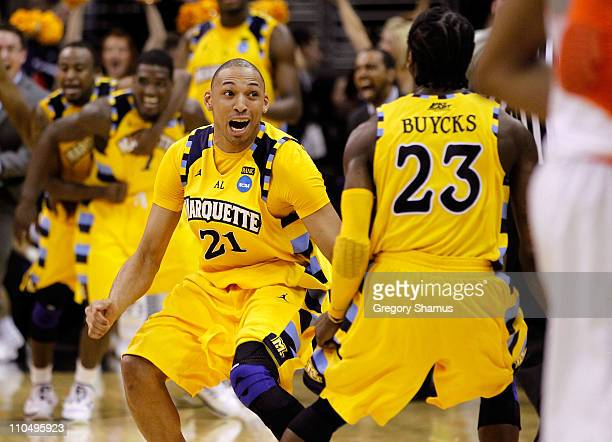 Joseph Fulce and Dwight Buycks of the Marquette Golden Eagles celebrate after defeating the Syracuse Orange during the third of the 2011 NCAA men's...