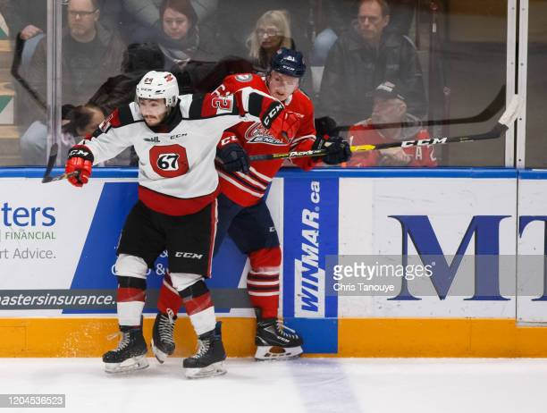 Joseph Garreffa of the Ottawa 67's bodychecks Allan Mcshane of the Oshawa Generals during an OHL game at the Tribute Communities Centre on March 1,...