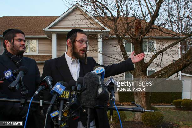 Joseph Gluck talks to the press as he describes the machete attack that took place earlier outside a rabbi's home during the Jewish festival of...