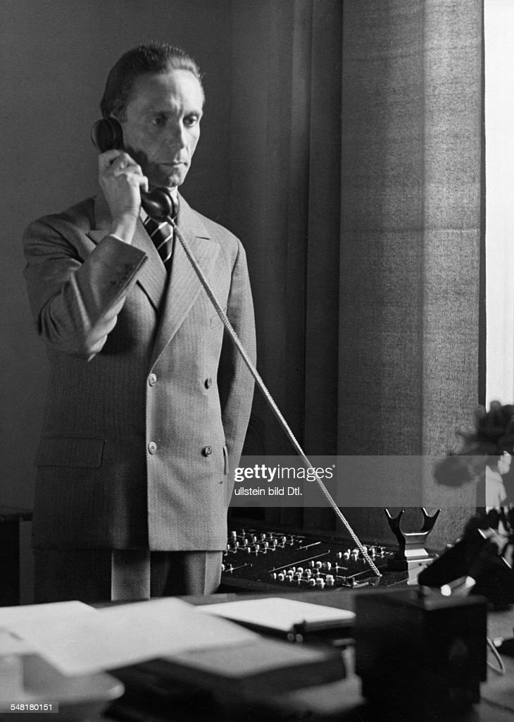 Joseph Goebbels *29.10.1897-01.05.1945+ Politician, Nazi Party, Germany - on the phone in his study - late October 1933 - Photographer: James E. Abbe - Vintage property of ullstein bild : Nachrichtenfoto
