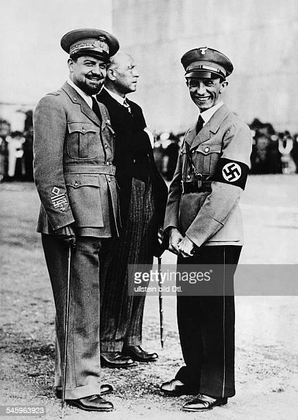 Joseph Goebbels auf dem MilitärflugplatzCiampino bei Rom in Erwartung der erstenLandung eines Zeppelins; in der Gruppe Luftfahrtminister GeneralItalo...