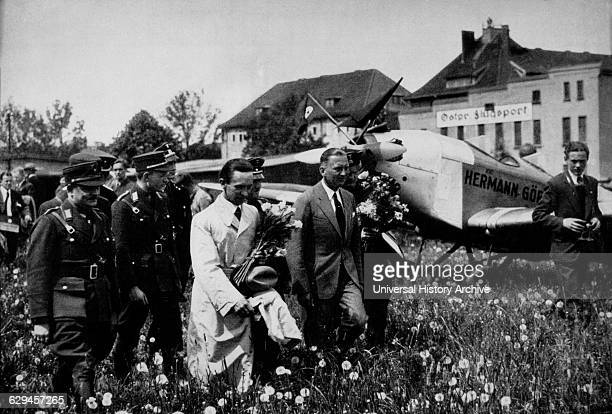 Joseph Goebbels Center Foreground Wearing White Trench coat and Holding Flowers at Konigsberg Airport East Prussia 1933