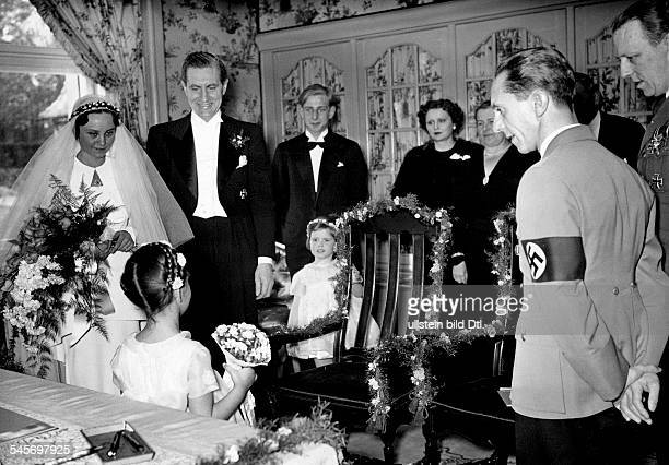Joseph Goebbels on the occasion of his sisters marriage his sister Maria and her husband film director Max Kimmich getting flowers from Goebbels'...
