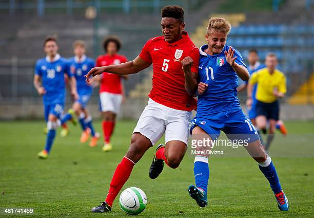 Joseph Gomez of England competes for the ball with Antonio Panico of Italy during the UEFA U17 Championship Qualifier Elite Round match between Italy...