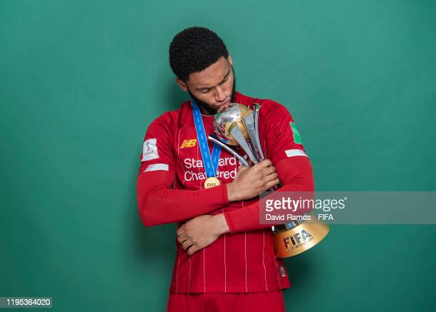 Joseph Gomez of Liverpool poses with the Club World Cup trophy after the FIFA Club World Cup Qatar 2019 Final match between Liverpool and CR Flamengo...