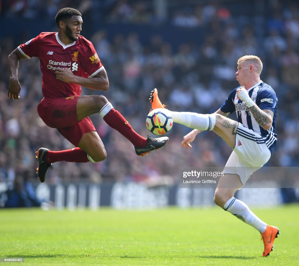 Joseph Gomez of Liverpool rises for the ball under pressure from James McClean of West Bromwich Albion during the Premier League match between West Bromwich Albion and Liverpool at The Hawthorns on April 21, 2018 in West Bromwich, England.