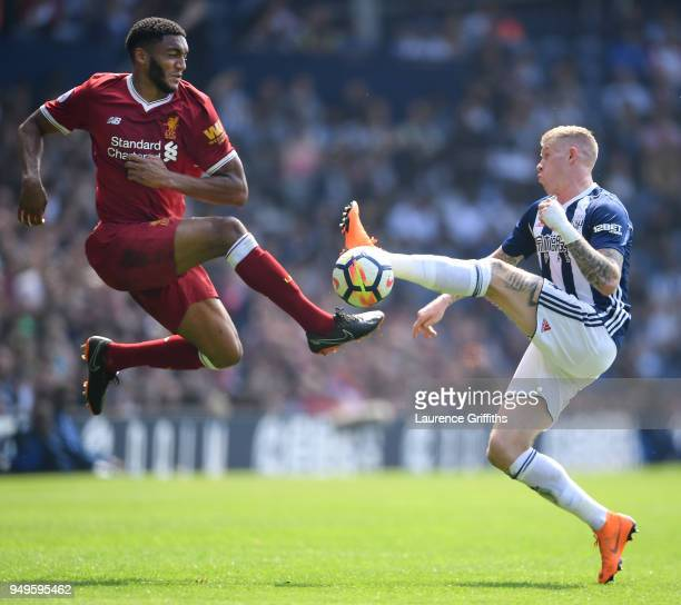 Joseph Gomez of Liverpool rises for the ball under pressure from James McClean of West Bromwich Albion during the Premier League match between West...
