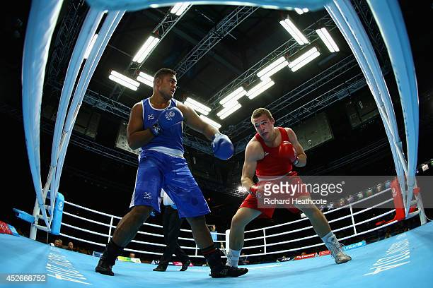 Joseph Goodhall of Australia in action against Patrick Mailata of New Zealand in the Men's Super Heavy 91kg preliminaries at Scottish Exhibition And...