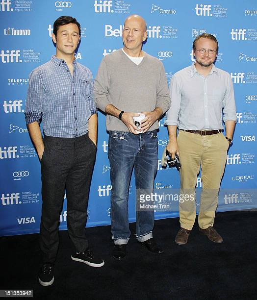 Joseph GordonLevitt Bruce Willis and Rian Johnson arrive at the Looper photo call during the 2012 Toronto International Film Festival held at TIFF...