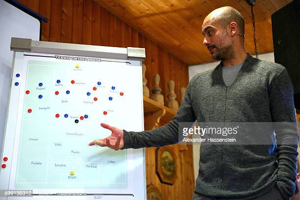 Joseph Guardiola, head coach of FC Bayern Muenchen shows tactical moves on a tactics board during his visit to the FC Bayern Muenchen supporter club...