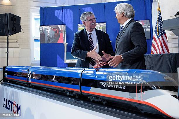 Joseph H. Boardman , President of Amtrak, and Jerome Wallut, President of Alstom Transportation Inc., shake hands after unveiling a new high speed...