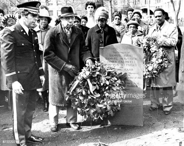 Joseph H Nelson of the Boston Equal Rights League places a wreath on the grave of victims of the Boston Massacre at the Granary Burying Ground in...