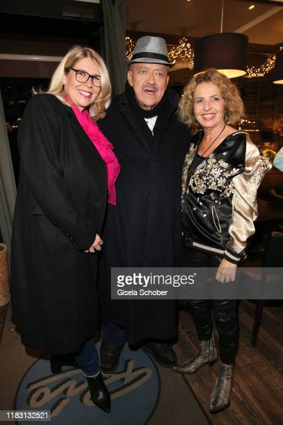 """Joseph Hannesschlaeger and his wife Bettina Geyer and Michaela May during the premiere of the film """"Schmucklos"""" at Rio Filmpalast on November 17,..."""