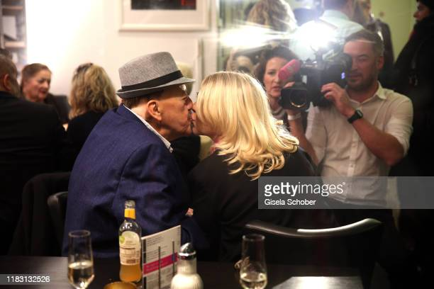 """Joseph Hannesschlaeger and his wife Bettina Geyer kiss during the premiere of the film """"Schmucklos"""" at Rio Filmpalast on November 17, 2019 in Munich,..."""