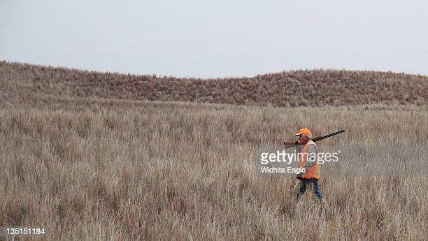 Joseph Herzog of Stafford Virginia walks while hunting for lesser prairie chickens in Edwards County Kansas November 23 2011